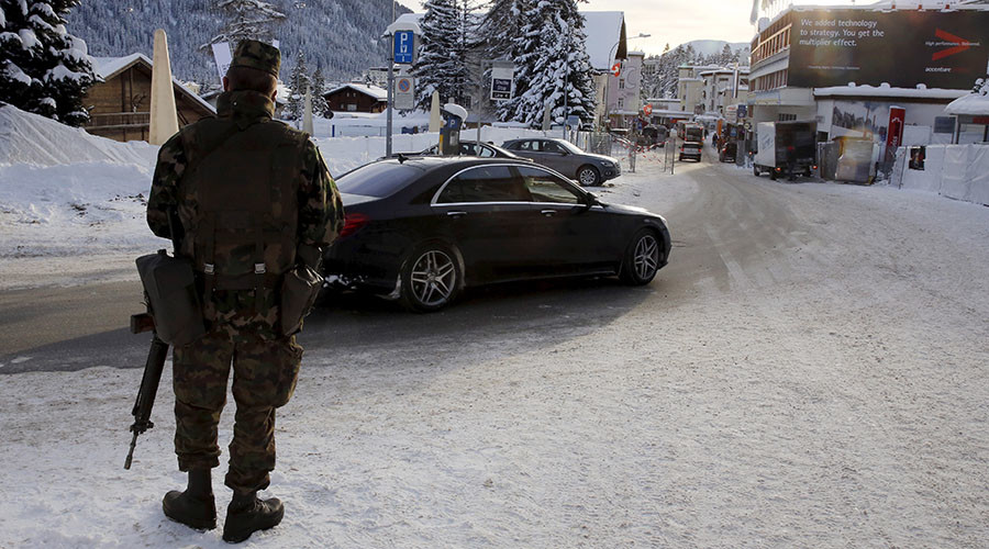 A Swiss army soldier patrols downtown Davos ahead of the Annual Meeting 2016 of the World Economic Forum (WEF) in Davos, Switzerland January 18, 2016. © Ruben Sprich