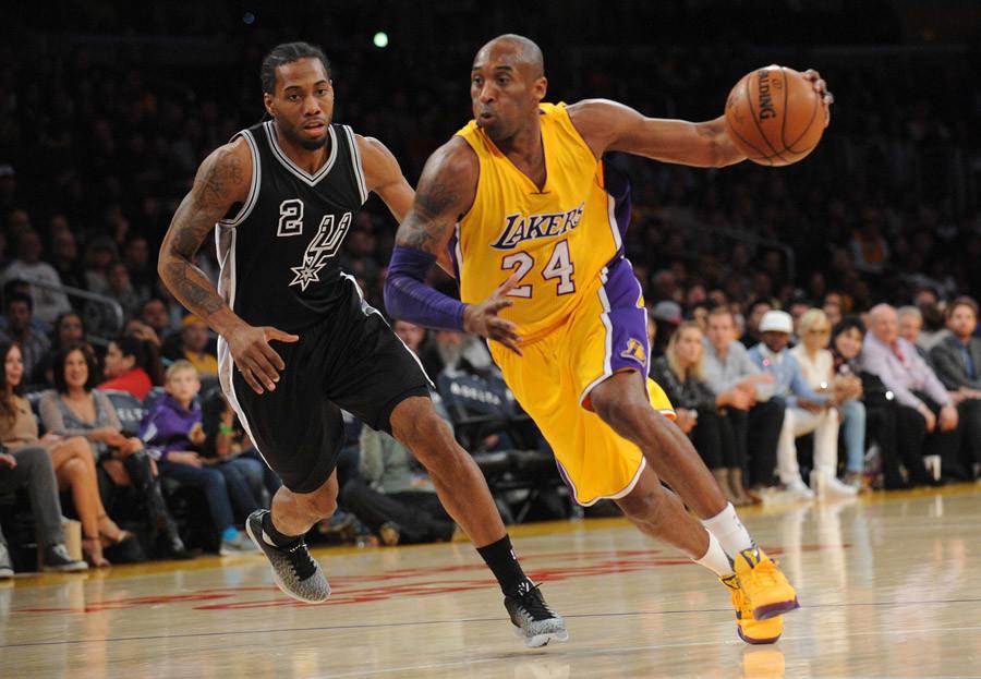Kobe Bryant (24) moves to the basket against San Antonio Spurs forward Kawhi Leonard (2) © Gary A. Vasquez