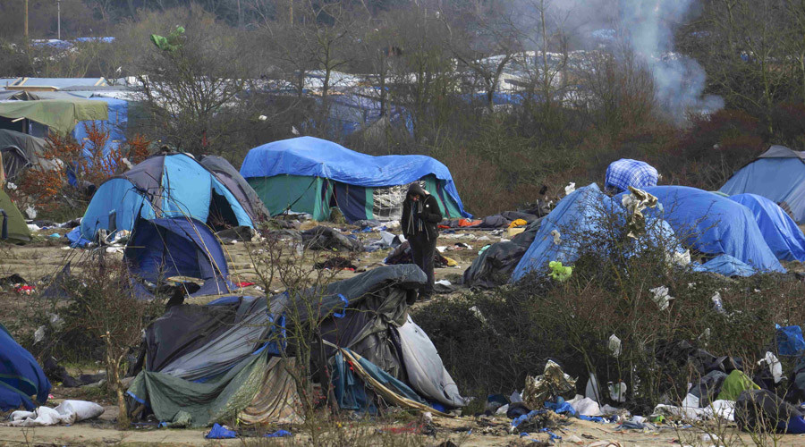 "A migrant stands among dismantled shelters of the camp known as the ""Jungle"", a squalid sprawling camp in Calais, northern France, January 18, 2016. © Pascal Rossignol"