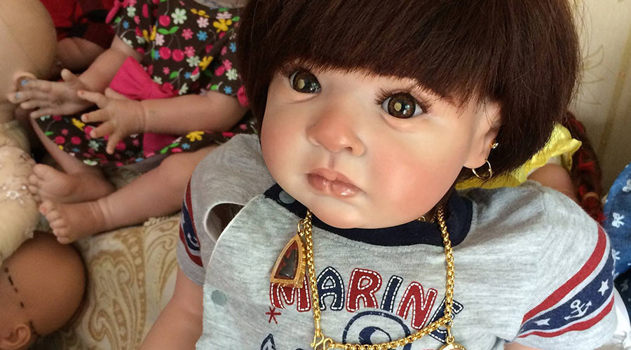 Thai 'child angel' dolls get seats in airliner, one seized by police for drug smuggling