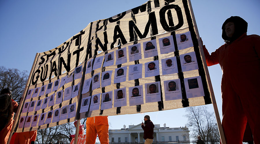 Protesters in orange jumpsuits from Amnesty International USA and other organizations rally outside the White House to demand the closure of the U.S. prison at Guantanamo Bay, in Washington January 11, 2016. © Jonathan Ernst
