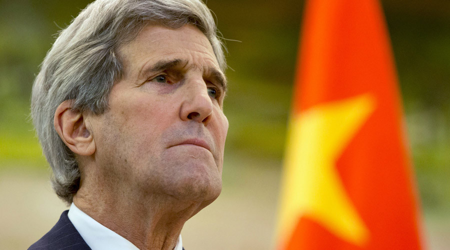 U.S. Secretary of State John Kerry listens to an opening statement by Chinese Foreign Minister Wang Yi during a news conference at the Ministry of Foreign Affairs in Beijing, China January 27, 2016. © Jacquelyn Martin