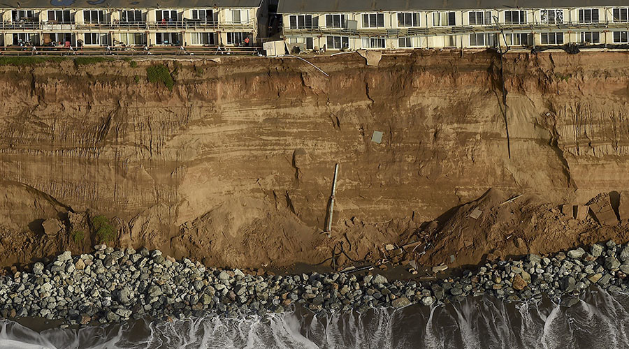 Uninhabitable apartment buildings, in danger of collapsing into the Pacific Ocean, line Esplanade Ave. in Pacifica, California January 26, 2016. The city has marked three apartment complexes uninhabitable as El Nino storm erosion eats away at the coastal bluff beneath them. © Noah Berger