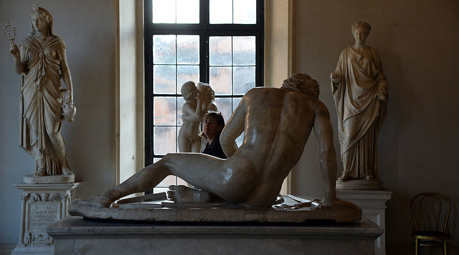 A visitor walks past marble statues on display at Rome's Capitoline Museum (Musei Capitolini) on Capitol Hill on January 26, 2016. © Filippo Monteforte