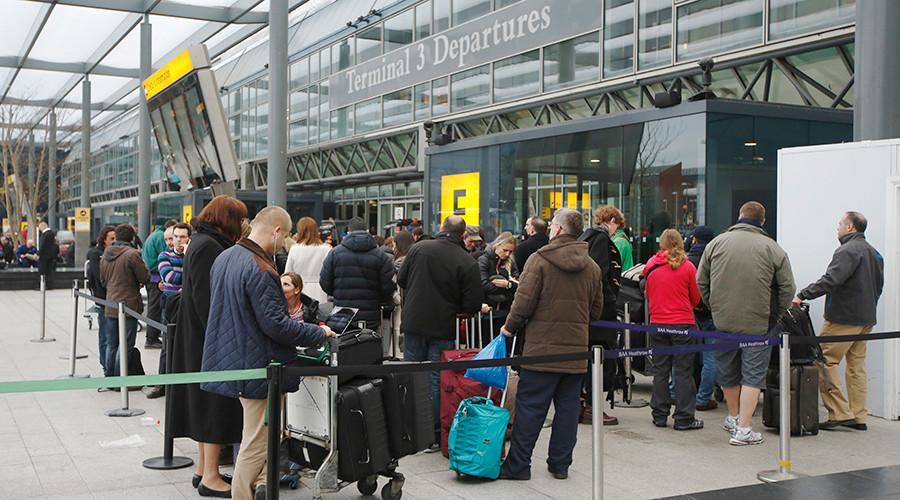 Passengers queue outside Terminal 3 at Heathrow Airport in west London © Luke MacGregor