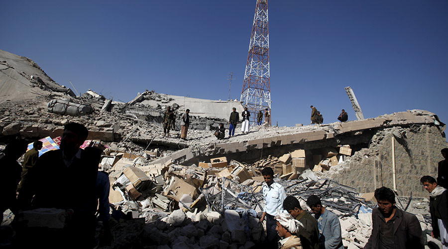Policemen stand on the collapsed roof of the police headquarters after it was destroyed by a Saudi-led air strike in Yemen's capital Sanaa © Khaled Abdullah