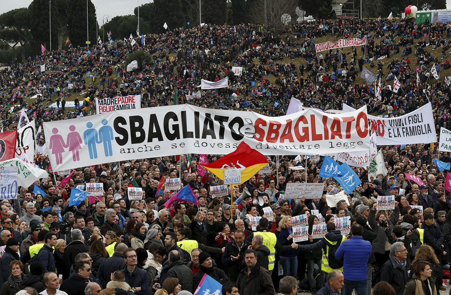"Protesters hold a banner reading ""It is wrong even if it becomes law"" during a rally against same-sex unions and gay adoption in Rome, Italy January 30, 2016. © Remo Casilli"