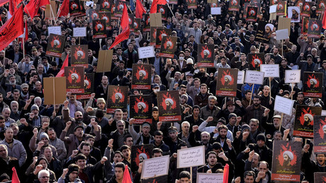 Iranian protesters hold pictures of prominent Shi'ite cleric Sheikh Nimr al-Nimr during a demonstration against the execution of al-Nimr in Saudi Arabia, at Imam Hussein square in Tehran January 4, 2016. © Raheb Homavandi