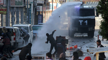 Riot police use a water cannon to disperse stone throwing Kurdish demonstrators during a protest against the curfew in Sur district, in the southeastern city of Diyarbakir, Turkey, December 22, 2015. © Sertac Kayar