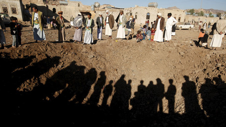 People stand around a crater caused by a Saudi-led air strike on the outskirts of Yemen's capital Sanaa December 29, 2015. © Khaled Abdullah