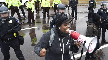 A protester named Oluchi of Minneapolis speaks to protesters after they shut down the main road to the Minneapolis St. Paul Airport following a short protest at the Mall of America in Bloomington, Minnesota December 23, 2015. © Craig Lassig