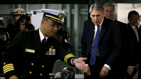 Britain's Foreign Secretary Philip Hammond (C) and Defense Secretary Michael Fallon  inspect Japan's Maritime Self-Defense Force (JMSDF)'s biggest warship Izumo in Yokosuka, south of Tokyo, Japan. © Issei Kato