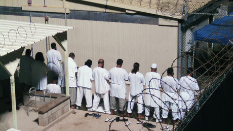 Detainees participate in an early morning prayer session at Camp IV at the detention facility in Guantanamo Bay U.S. Naval Base © Deborah Gembara