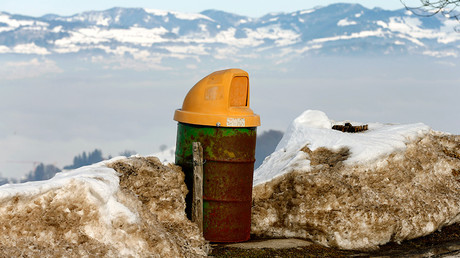 An old oil barrel is used as a rubbish bin beside a mountain road near the village of Schindellegi south of Zurich © Arnd Wiegmann