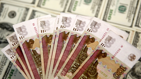 A picture illustration shows U.S. Dollar and Russian Ruble banknotes © Dado Ruvic