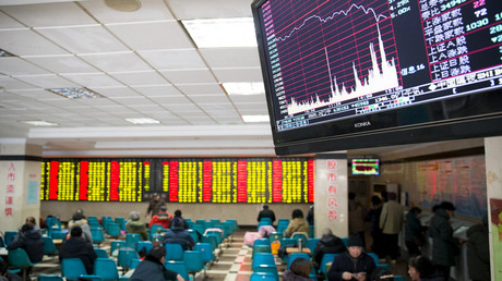 A screen showing stock information is seen at a brokerage house in Nanjing, Jiangsu province, January 26, 2016. © China Daily