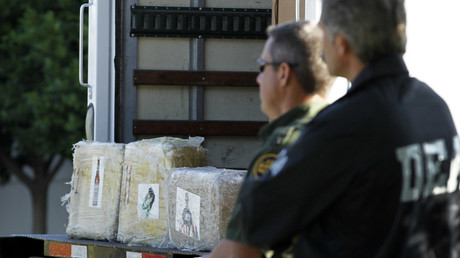 A Drug Enforcement Administration (DEA) agent and a border patrol officer © Mike Blake