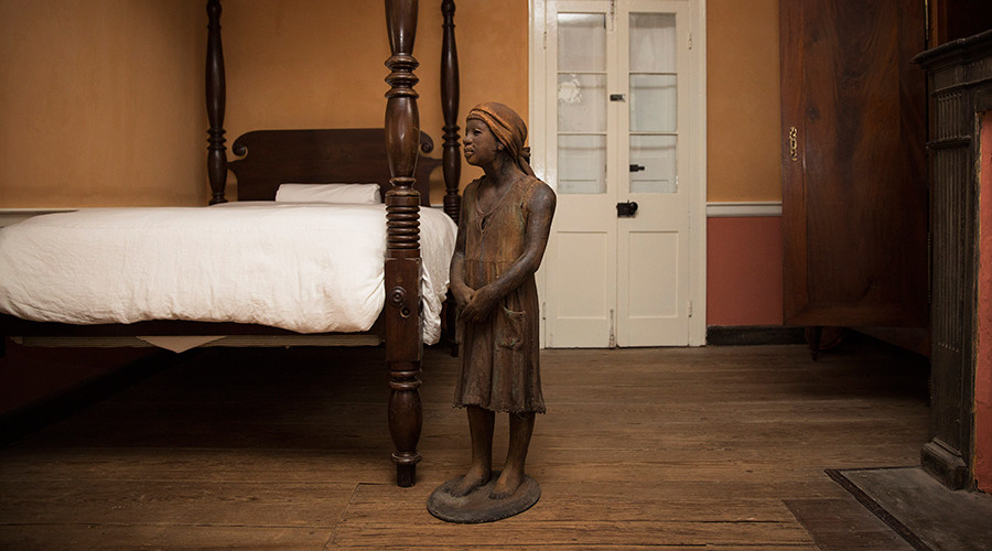 A terra-cotta statue of a child slave inside the main house at the Whitney Plantation in Wallace, Louisiana © Edmund Fountain