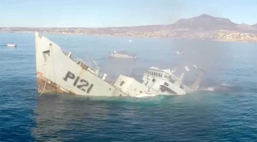 That sinking feeling: Explosive on-board footage shows battleship drop beneath the waves (VIDEO)