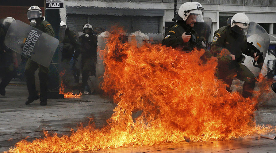 Riot police react to petrol bombs thrown by masked youths in Syntagma Square during a 24-hour general strike against planned pension reforms in Athens, Greece, February 4, 2016. ©Alkis Konstantinidis