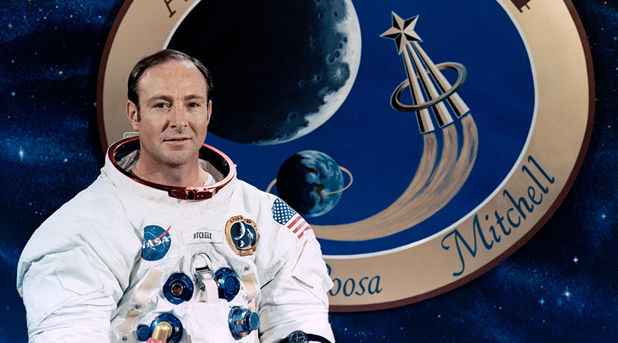 Apollo astronaut Edgar Mitchell posing with the Apollo 14 mission patch in 1971 © NASA