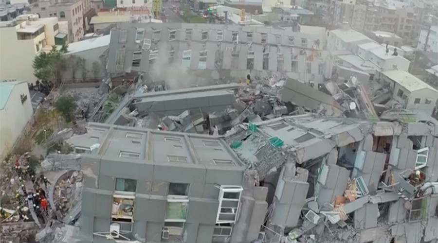Taiwan residential tower toppled by deadly 6.4 quake (AERIAL FOOTAGE)