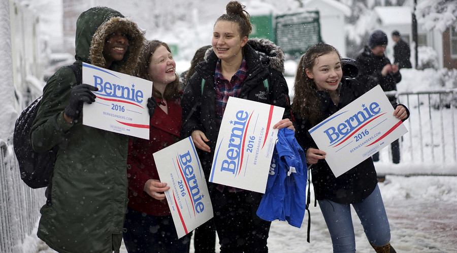 Girls supporting U.S. Democratic presidential candidate Bernie Sanders cheer for Bernie during snowfall outside a campaign event in Exeter, New Hampshire February 5, 2016. © Rick Wilking