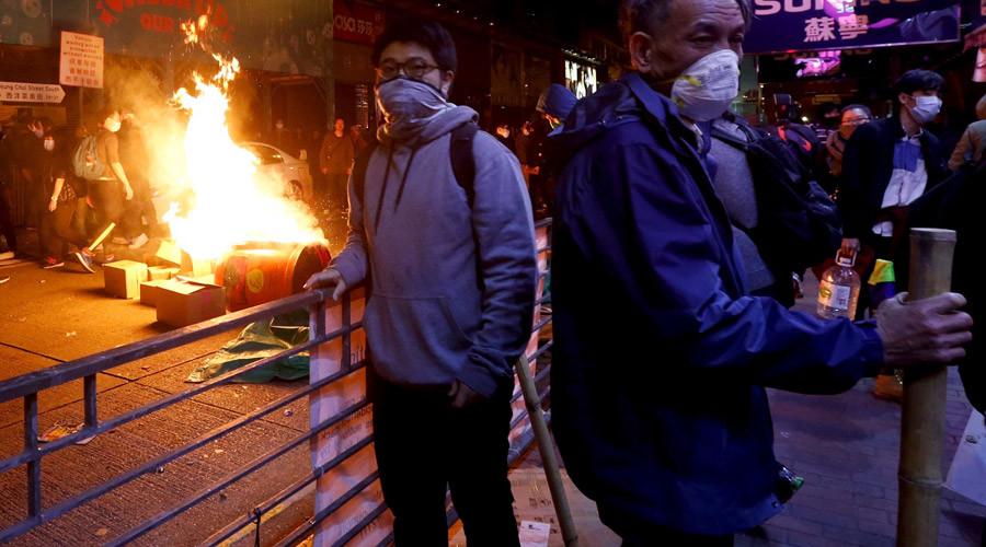 Protesters set fire at a junction at Mongkok shopping district in Hong Kong, China February 9, 2016. © Bobby Yip