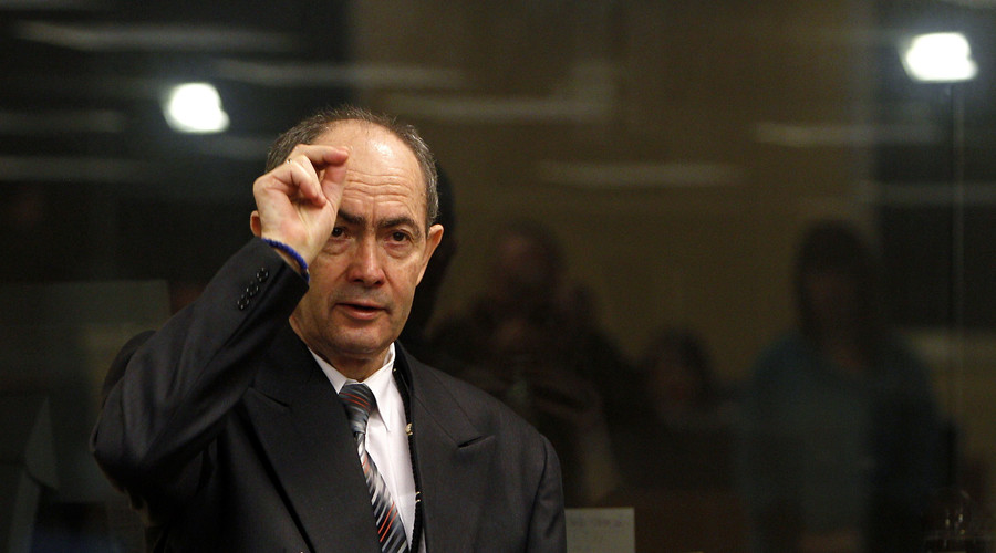 Former Bosnian Serb general Zdravko Tolimir crosses himself after arriving in the courtroom for the start of his trial at the Yugoslav war crimes tribunal in The Hague February 26, 2010. © Bas Czerwinski