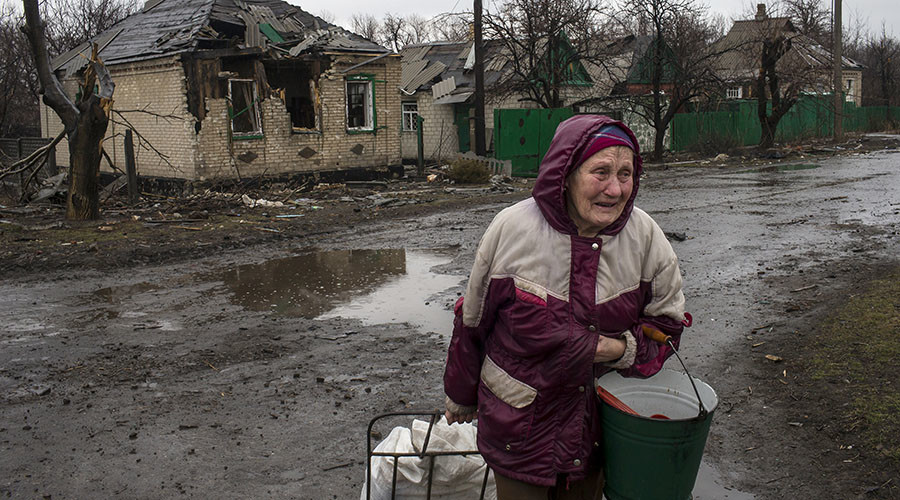 A woman cries as she walks past destroyed houses in the town of Debaltseve, north-east from Donetsk, March 13, 2015. © Marko Djurica