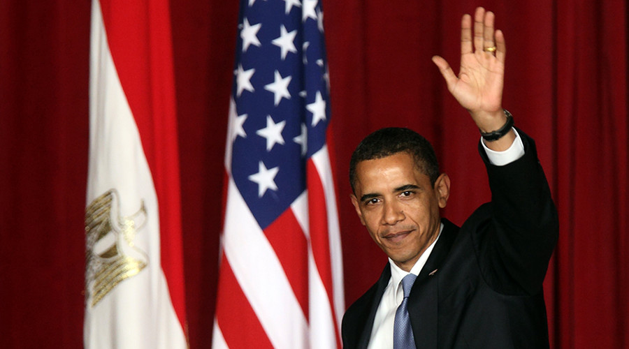 U.S. President Barack Obama waves to the audience as he leaves the Grand Hall of Cairo University after delivering a speech in Cairo June 4, 2009. © Goran Tomasevic / Reuters