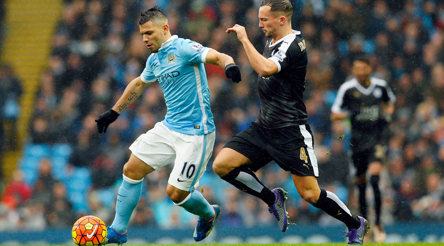 Manchester City's Sergio Aguero (L) in action with Leicester City's Daniel Drinkwater © Jason Cairnduff