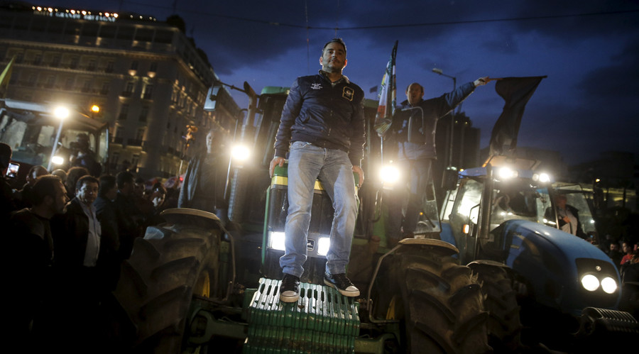 Farmers are seen on a tractor during a protest against planned pension reforms in front of the parliament building in Athens, Greece February 12, 2016. © Alkis Konstantinidis