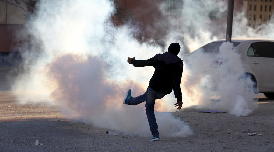 A protester kicks a tear gas canister fired by riot police away from fellow protesters during anti-government clashes in the village of Sitra, south of Manama, February 14, 2016. © Hamad I Mohammed