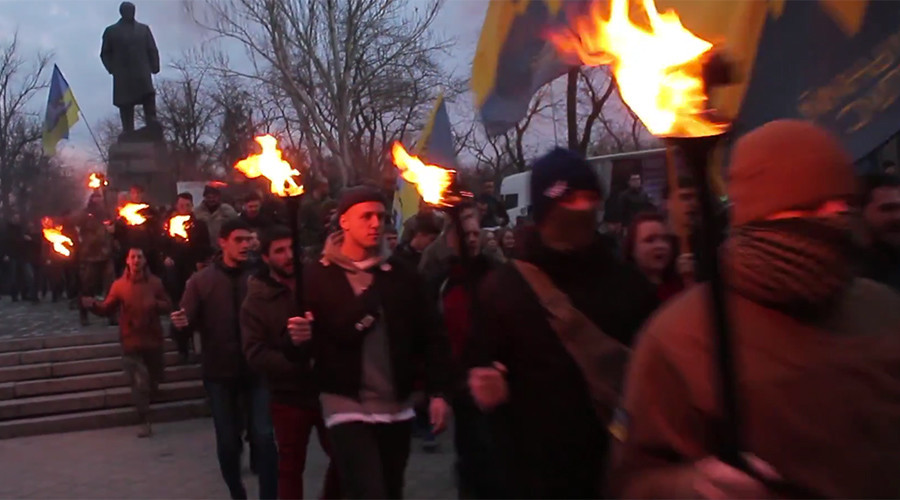 Ukrainian far-right fighters hold Nazi-inspired torch march in Odessa to commemorate slain friends