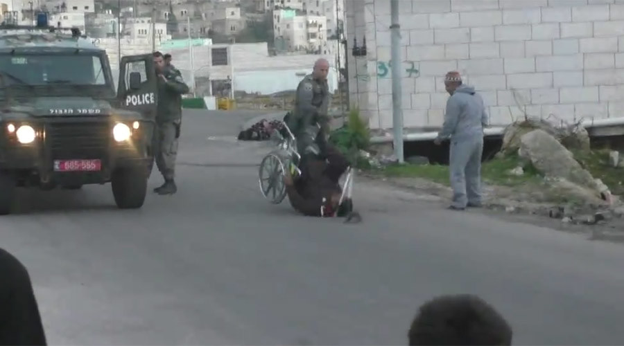 Israeli border police officer flips Palestinian man from wheelchair (VIDEO)