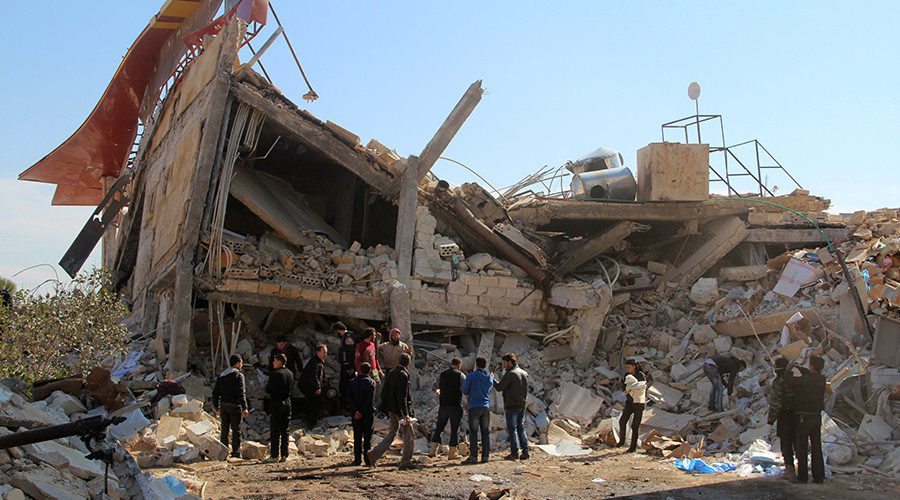People gather around the rubble of a hospital supported by Doctors Without Borders (MSF) near Maaret al-Numan, in Syria's northern province of Idlib, on February 15, 2016 ©  GHAITH OMRAN