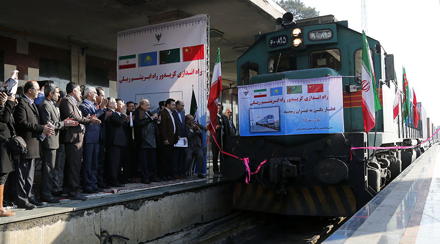 Iranian officials applaud on the platform as the first train connecting China and Iran arrives at Tehran Railway Station on February 15, 2016. © Stringer
