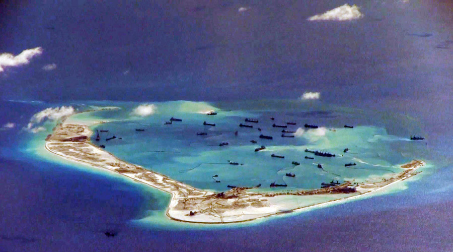Chinese dredging vessels seen in the waters around Mischief Reef in the disputed Spratly Islands in the South China Sea. © HO