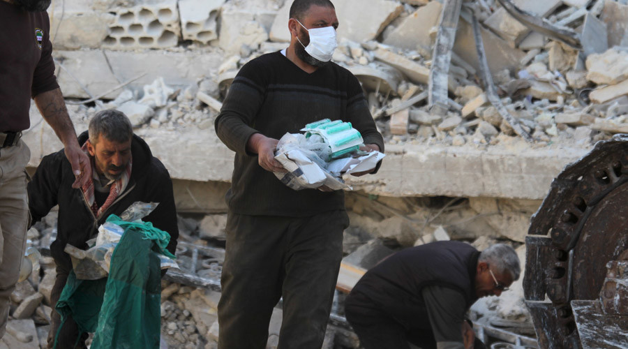 People carry medical supplies found under the rubble of a destroyed Medecins Sans Frontieres (MSF) supported hospital hit by missiles in Marat Numan, Idlib province, Syria, February 16, 2016. © Ammar Abdullah