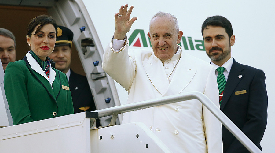 Pope Francis waves as he boards a plane at Fiumicino Airport in Rome, Italy February 12, 2016 © Tony Gentile