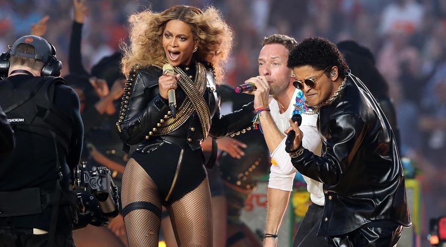 Recording artist Beyonce, Coldplay singer Chris Martin and recording artist Bruno Mars perform during halftime in Super Bowl 50 at Levi's Stadium.  © Matthew Emmons