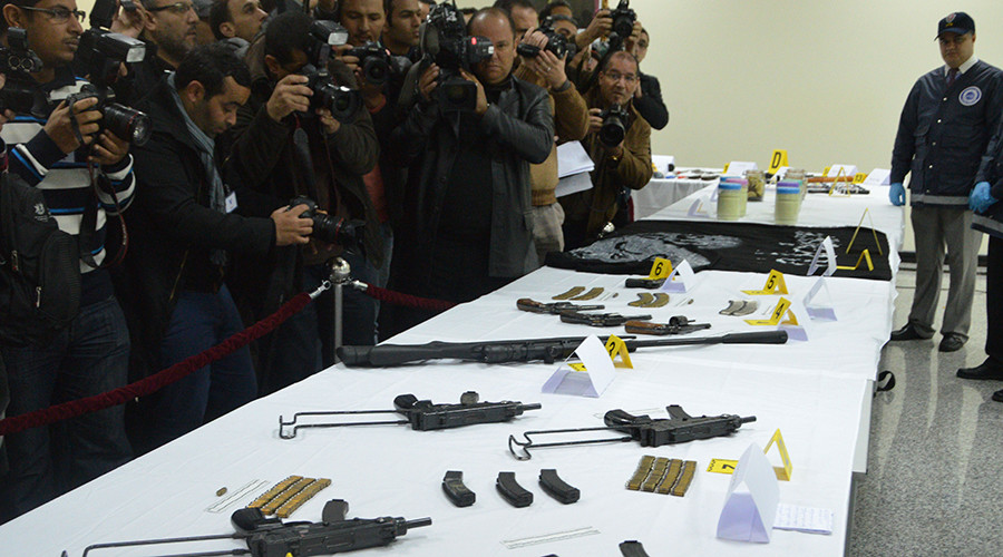 "A member of the of the Central Office of Criminal Investigation (BCIJ) shows during a press conference by the BCIJ's chief Abdelhak el-Khiam, ammunition and weapons seized by Moroccan authorities as they carried out raids against a ""terrorist cell"", in the capital Rabat, on February 19, 2016. © AFP"