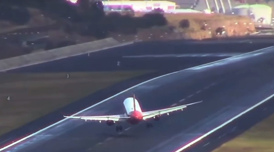 One bumpy ride: Passenger jets blown about before landing at 'Europe's scariest airport' (VIDEO)