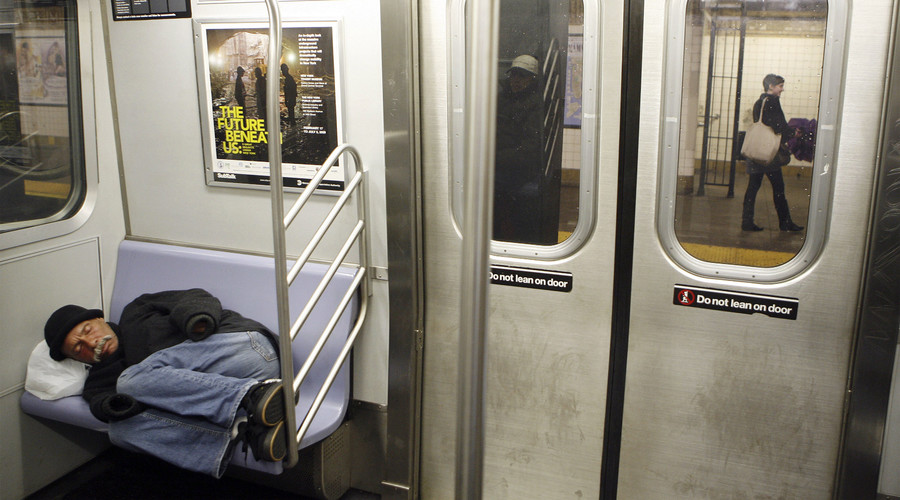 A man sleeps while riding the subway in New York. © Lucas Jackson