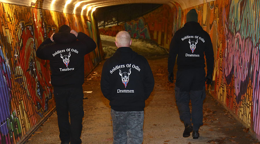 "Members of the so-called ""Soldiers of Odin"" volunteer street patrol are pictured as they patrol through the streets of Drammen, Norway, on Sunday night, February 21, 2016.  © Heiko Junge / NTB Scanpix"