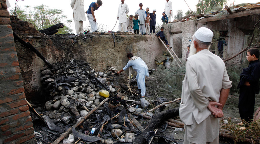 Afghans inspect a damaged house after a drone crash last night in Jalalabad, August 21, 2011. © Parwiz