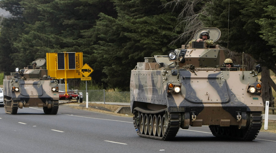 Australia to bolster defenses, wants to keep good terms with both US and China