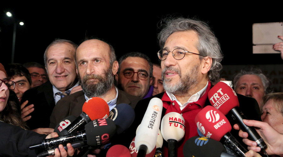 Can Dundar, editor-in-chief of Cumhuriyet, (R), accompanied by his Ankara bureau chief Erdem Gul, speaks to the media after being released from prison outside the Silivri prison complex near Istanbul, Turkey early February 26, 2016. © Can Erok