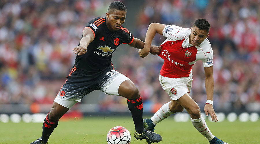 Manchester United's Antonio Valencia in action with Arsenal's Alexis Sanchez. © Carl Recine